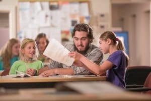 student tutoring kids