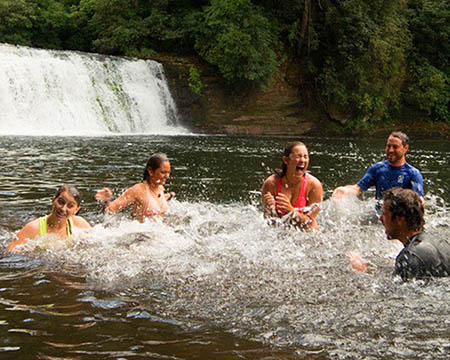 Students swimming at hooker falls wilderness excursion