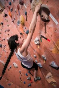 climber on rock wall