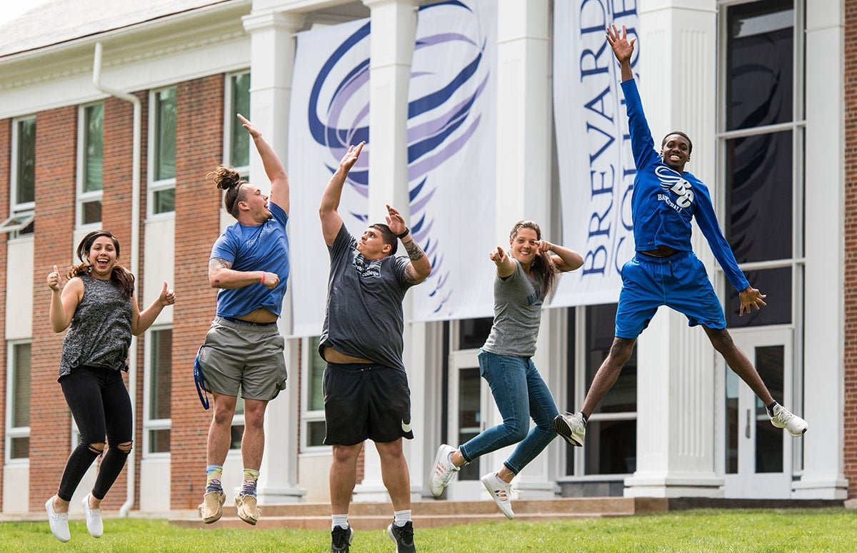 Students jumping in the Brevard College academic quad