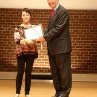 Christina Bailey receives award from President Joyce