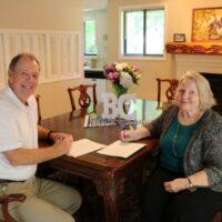 President David C. Joyce and President of the Brevard College Alumni Association, Jenny Munro, sign the scholarship agreement.